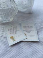 Tag que acompanha a lembrancinha de Água Benta em frasco de formato de Santinha